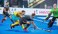 BHUBANESWAR, INDIA - Thijs van Dam (Ned) met keeper Andrew Charter (Aus)  en Jeremy Hayward (Aus)  tijdens de halve finale tussen Nederland en Australie bij het WK Hockey heren in het Kalinga Stadion.  COPYRIGHT KOEN SUYK