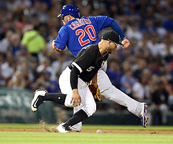 July 26, 2017 - Chicago, IL, USA - Chicago White Sox infielder Yolmer Sanchez (5) drops the ball for an error during the fifth inning as the Chicago Cubs' Victor Caratini (20) advances to third base at Guaranteed Rate Field in Chicago on Wednesday, July 26, 2017. (Credit Image: © Nuccio Dinuzzo/TNS via ZUMA Wire)