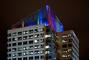 Alaska, Anchorage, downtown, JL Tower buiilding is lit up with LEED  lights  on their roof in winter