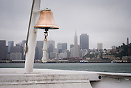 On a cold day in July, the view of San Francisco from the Golden Gate Ferry, skyline shrouded in fog.