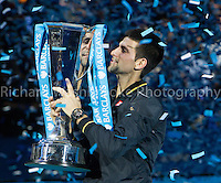 Barclays ATP World Tour Finals 2012 ..Novak Djokovic (SRB) celebrates by lifting the trophy after he beats Roger Federer (SUI)  7:6  7:5 in the Final..Images taken by Richard Washbrooke.