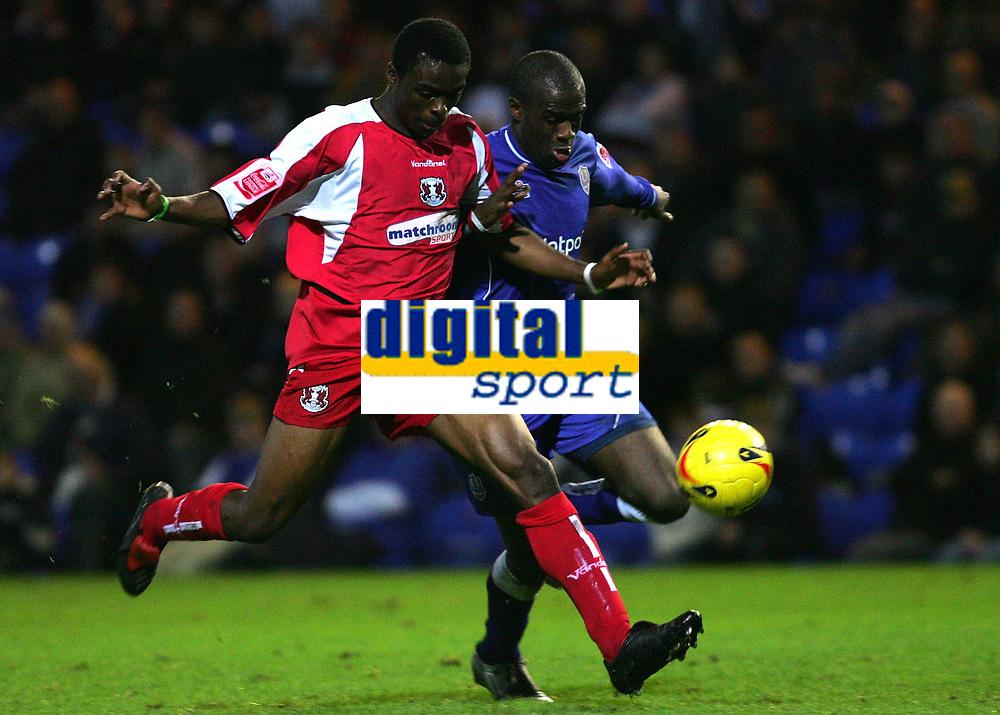 Photo: Frances Leader.<br />Peterborough Utd v Leyton Orient. Coca Cola League 2.<br />12/11/2005.<br />Orient's Gabriel Zakuani and Borough's Calum Willock (R) run for the ball.