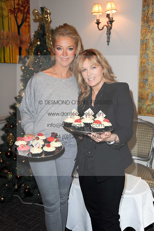 Left to right, TAMARA BECKWITH and AMANDA KYME at a shopping afternoon hosted by Amanda Kyme and Tamara Beckwith featuring designs from Elizabeth Hurley held at the Cadogan Hotel, 75 Sloane Street, London SW1 on 23rd November 2010.