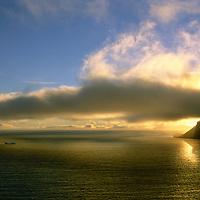 FRANZ JOSEF LAND, RUSSIA. Sunset over Arctic Ocean & Cape Grant on George Island in this polar archipeligo.