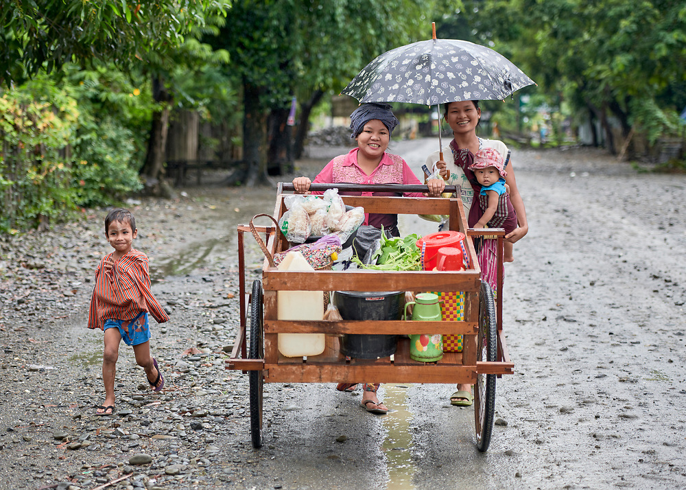 Women push their carts home after selling in the market in Tuingo, an ethnic Chin village in Myanmar.