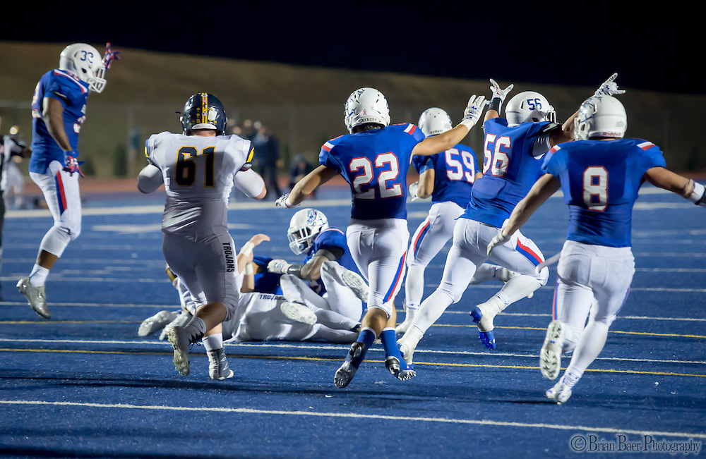 The Folsom High School Bulldogs defense reacts to stopping the point after attempt by Oak Ridge Trojans that would give them a 17-16 victory during the fourth quarter as the Folsom High School Bulldogs varsity football team host the Oak Ridge High School Trojans,  Friday Nov 4, 2016.<br /> photo by Brian Baer