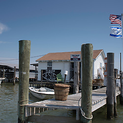 "August 4, 2017 - Tangier Island, VA - Tangier Island Mayor James ""Ooker: Eskridge's crab shanty proudly flies the American flag and the Israeli flag, a nod to the support, conservative Christian's on the island give to the Israeli state.  Photo by Susana Raab/Institute"