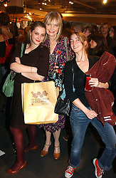 Left to right, MISS DAISY DE VILLENEUVE, JAN DE VILLENEUVE and MISS POPPY DE VILLENEUVE at a Topshop hosted Jumbo Thrift Sale - a sale of designer fashion, in association with the Terence Higgins Trust for World Aids Day, held at Topshop, Oxford Circus, London on 1st December 2004.<br /><br />NON EXCLUSIVE - WORLD RIGHTS
