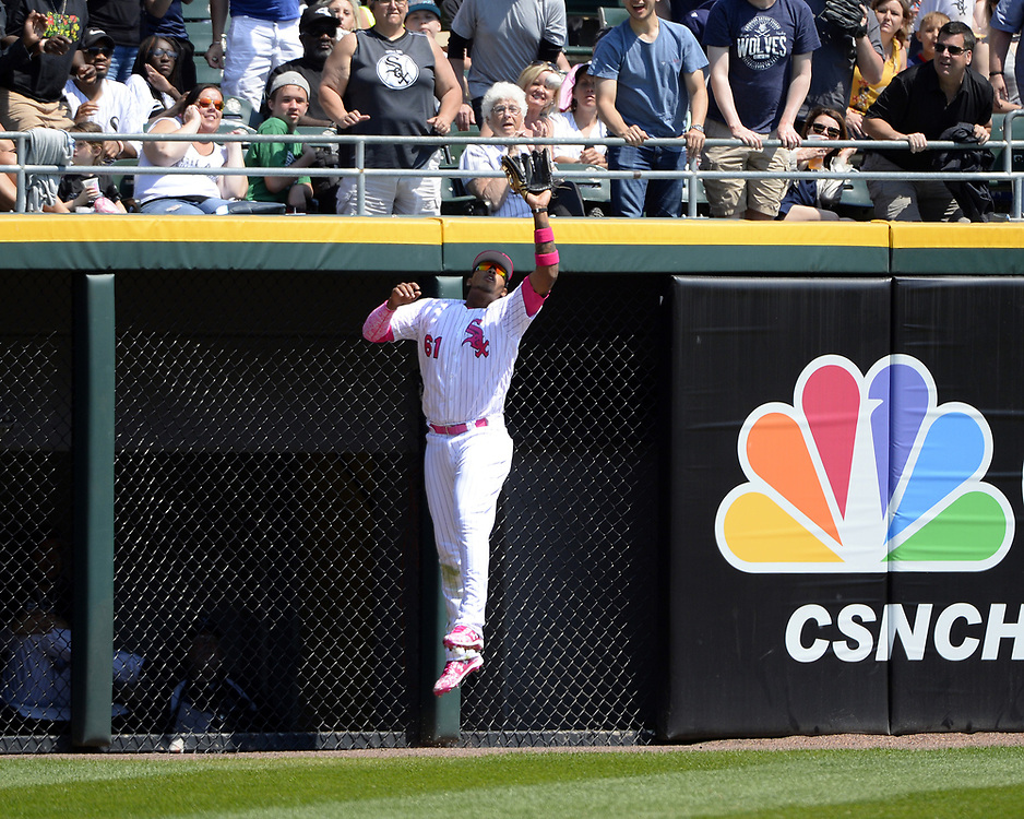 CHICGO - MAY 14:  Willy Garcia #61 of the Chicago White Sox makes a running catch against the San Diego Padres on May 14, 2017 at Guaranteed Rate Field in Chicago, Illinois.  The White Sox defeated the Padres 9-3 .  (Photo by Ron Vesely)  Subject: Willy Garcia