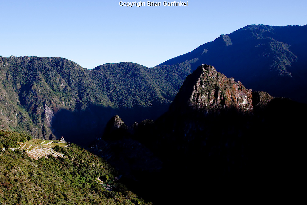 A view of the Inca's Machu Picchu during sunrise before the sun hits the temple