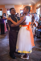 """Aiden Liburd and Maykala Hendrington.  Students of Dancing Classrooms of the Virgin Islands dance at a reception for their parents, family community, and school partners at the Virgin Islands Council on the Arts.  Students spent weeks learning the Tango, Foxtrot, Meringue, Swing, Rumba, and Waltz that will culminate in """"Colors of the Rainbow"""" team match competition at Reichhold Center for the Arts on Saturday, May 9, 2015.  St. Thomas, USVI.  8 May 2015.   © Aisha-Zakiya Boyd"""