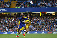Michy Batshuayi of Chelsea in action while being marked closely by Peter Hartley of Bristol Rovers. EFL Cup 2nd round match, Chelsea v Bristol Rovers at Stamford Bridge in London on Tuesday 23rd August 2016.<br /> pic by John Patrick Fletcher, Andrew Orchard sports photography.