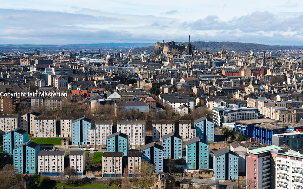 View over city of Edinburgh towards Edinburgh Castle with apartment buildings in Dumbiedykes in foreground, Scotland, UK
