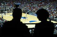 19 MAR 2015: Troy Caupain (10) of University of Cincinnati looks for the open play against Jon Octeus (0) of Purdue University during the 2015 NCAA Men's Basketball Tournament held at the KFC Yum! Center in Louisville, KY. Cincinnati defeated Purdue 66-65 in overtime. Brett Wilhelm/NCAA Photos