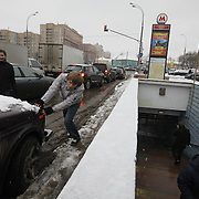 A man pushes his Lada car at the Taganskaya metro station on the Moscow Ring line. .The Moscow Metro, which spans almost the entire Russian capital, is the world's second most heavily used metro system after the Tokyo's twin subway. Opened in 1935, it is well known for the ornate design of many of its stations, which contain outstanding examples of socialist realist art.