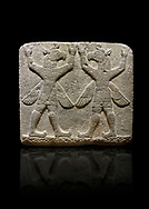 """Photo of Hittite relief sculpted orthostat stone panel of Herald's Wall Basalt, Karkamıs, (Kargamıs), Carchemish (Karkemish), 900-700 B.C. Bird-headed, winged figures of human body. Anatolian Civilisations Museum, Ankara, Turkey.<br /> <br /> These figures are called as """"Winged Griffin Demons"""". Embossing is constructed symmetrically. Their hands are on their heads. It is assumed that they carry the heavens. <br /> <br /> Against a black background. .<br />  <br /> IIf you prefer to buy from our ALAMY STOCK LIBRARY page at https://www.alamy.com/portfolio/paul-williams-funkystock/hittite-art-antiquities.html  - Type  Karkamıs in LOWER SEARCH WITHIN GALLERY box. Refine search by adding background colour, place, museum etc.<br /> <br /> Visit our HITTITE PHOTO COLLECTIONS for more photos to download or buy as wall art prints https://funkystock.photoshelter.com/gallery-collection/The-Hittites-Art-Artefacts-Antiquities-Historic-Sites-Pictures-Images-of/C0000NUBSMhSc3Oo"""