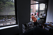 MANHATTAN, NEW YORK, AUGUST 13, 2009<br />People try to see a closer view of a robbery and murder scene at 125th Street between Broadway and Amsterdam Avenues in Manhattan, NY.  The store owner of Blue Fame shot four people who tried to rob him this afternoon. 8/14/2009 Photo by Jennifer S. Altman/For The Times