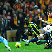 Galatasaray's Emmanuel Eboue (2ndR) during their Turkish superleague soccer derby match Galatasaray between Fenerbahce at the TT Arena in Istanbul Turkey on Friday, 18 March 2011. Photo by TURKPIX