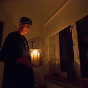 Hermit Sister Rachel Denton holds candles during the Compline or night prayers at St Cuthberts' Hermitage in Lincolnshire, north east Britain September 25, 2015. Sister Rachel Denton has vowed to spend the rest of her life living as a consecrated hermit in the Catholic faith. A hermit is a person who chooses to live alone, with the intention of finding God. Rarely leaving her house she lives a life of prayer and solitude. However, she uses the internet and social media to share her experience and distance her self from physically interacting with society. REUTERS/Neil Hall