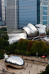 The Anish Kapoor designed sculpture Cloud Gate. Nicknamed The Bean and the Frank Gehry designed Jay Pritzker Pavilion in Millennium Park, Chicago