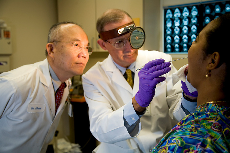 John Saunders MD Richard Hirata MD examine a patient (stand-in)
