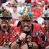 28 October 2007: Three fans pose during the Jacksonville Jaguars victory 24-23 over the Tampa Bay Buccaneers at Raymond James Stadium in Tampa, Florida.