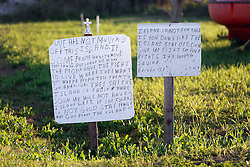 04 March 2016. Isle de Jean Charles, Louisiana.<br /> Vanishing land. First climate refugees in the USA. Isle de Jean Charles Band of Biloxi-Chitimacha Indians.<br /> 'We are not moving.' A defiant sign is posted next to a survival pod from an oil rig.<br /> Scenes from the disappearing bayou where the tribe has recently been awarded $52 million to resettle on higher ground as more and more of their land is consumed by erosion from the Gulf of Mexico.<br /> Photo©; Charlie Varley/varleypix.com