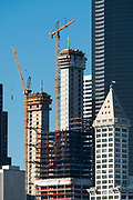 United States, Washington, Seattle, Smith Tower with building construction going on around it. 07/30/16
