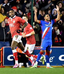 Doncaster's Reece Wabara throws his arms in the air after Bristol City's Jay Emmanuel-Thomas scores his second goal in the FA Cup third round replay between Bristol City and Doncaster Rovers at Ashton Gate on January 13, 2015 in Bristol, England. - Photo mandatory by-line: Paul Knight/JMP - Mobile: 07966 386802 - 13/01/2015 - SPORT - Football - Bristol - Ashton Gate Stadium - Bristol City v Doncaster Rovers - FA Cup third round replay