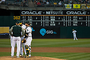 Oakland Athletics relief pitcher Bobby Wahl (63) and staff have a meeting at the mound during a game against the Miami Marlins at Oakland Coliseum in Oakland, Calif., on May 23, 2017. (Stan Olszewski/Special to S.F. Examiner)