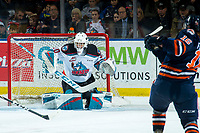 KELOWNA, BC - DECEMBER 27:  Roman Basran #30 of the Kelowna Rockets defends the net on a shot by Zane Franklin #16 of the Kamloops Blazers at Prospera Place on December 27, 2019 in Kelowna, Canada. (Photo by Marissa Baecker/Shoot the Breeze)