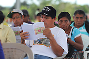 A TCGA member reads the 2012 Annual Report during the 2013 Annual General Meeting. Toledo Cacao Growers' Association (TCGA), Julian Cho Technical High School, Mile 14 Southern Highway, Toledo, Belize. January 26, 2013.