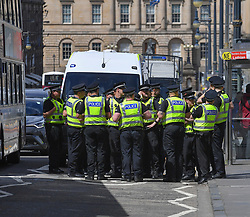Pictured: Police blocked off North Bridge to traffic for a while.<br /> <br /> Climate change protesters blocked roads in the city centre including North Bridge, causing severe traffic disruption.<br /> <br /> © Dave Johnston / EEm