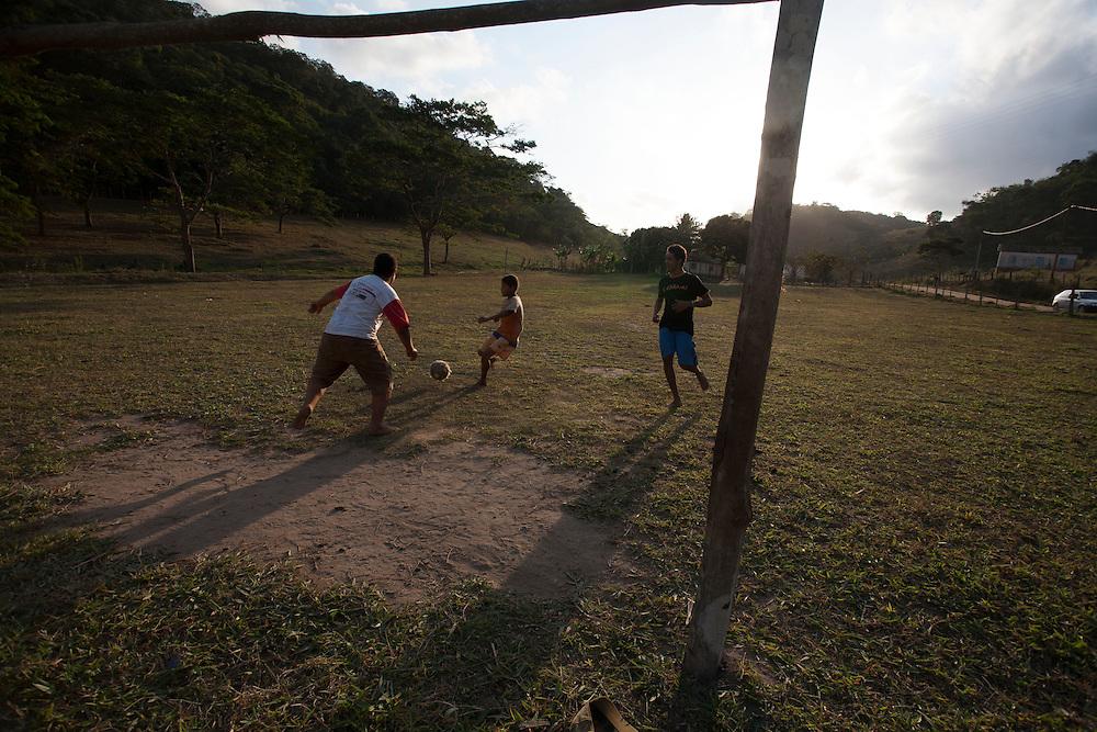 Ouro Verde de Minas_MG, Brazil.<br /> <br /> O municipio Ouro Verde de Minas, esta situado na regiao do Mucuri, foi distrito de Ataleia, criado em 1953, quando adotou o atual nome, por ser um dos grandes produtores de cafe da regiao. Na foto, meninos jogando futebol em um campinho.<br /> <br /> Ouro Verde de Minas is located in Mucuri region It was Ataleia district, created in 1953, when it adopted the current name, as one of the major producers of the coffee egion. In the photo, boys playing football on a soccer field.<br /> <br /> Foto: LEO DRUMOND / NITRO