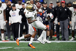 Auburn Tigers defensive back Jeremiah Dinson (20) breaks up a pass intended for UCF Knights wide receiver Dredrick Snelson (5) during the 2018 Chick-fil-A Peach Bowl NCAA football game on Monday, January 1, 2018 in Atlanta. (Jason Parkhurst / Abell Images for the Chick-fil-A Peach Bowl)