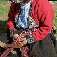 South America, Peru, Chinchero. Weaving a traditional sash.