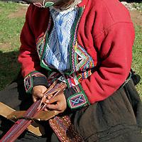 South America, Peru, Chinchero. Weaving a traditional sash.