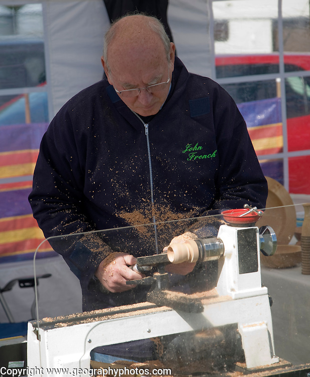 Man demonstrating wood turning, Mid and West Suffolk show, Stonham Barns, Suffolk, England