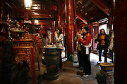 "Hanoi, Vietnam. March 11th 2007..Vietnamese women pray in the ""Van Mieu"", the Literature Temple"