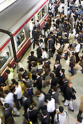 commuters entering a train during rush hour Japan Tokyo