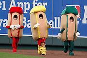 A contestant in the Kansas City Royals' Hotdog Run, center, loses his pants as they race between innings of a baseball game against the San Francisco Giants at Kauffman Stadium in Kansas City, Mo., Sunday, Aug. 10, 2014.  (AP Photo/Colin E. Braley)