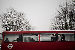 © Licensed to London News Pictures. 01/03/2018. London, UK. A group of young Orthodox Jewish men ride in a red London bus, as they celebrate the festival of Purim on the streets of Stamford Hill in north London on March 1, 2018. Purim celebrates the miraculous salvation of the Jews from a genocidal plot in ancient Persia, an event documented in the Book of Esther. Traditionally the jewish community wear fancy dress and exchange reciprocal gifts of food and drink. Photo credit: Ben Cawthra/LNP