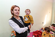 """Veronica is 24 years of age, she is a mother of four children and the fifth, a boy is in her womb. From 11 months the youngest to 7 years the oldest. She is from Askeran, a province nearby Stepanakert in Nagorno Karabakh. She is unemployed and her husband who is from Jabrayil served in the army as volunteer and managed to survive the war as he returned home on the 10th of November after the peace deal was reached between the leaders of Armenia and Azerbaijan. On Tuesday, Dec 28, 2020 - she said that they will not return to Nagorno Karabakh. Her family is now looking for opportunities to work and live in Armenia. They're now under Armenian government logistics support for food, shelter and other essential supplies. She is living at an abandoned building of former """"SOVIET Hotel"""" in Metsamor, which is located near the Armenian Nuclear Power Plant, that is the only nuclear power plant in the South Caucasus, located 36 kilometres west of Yerevan in Armenia."""