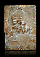 Stone relief sculptured panel fragment of a Genie blessing. Inv AO 19864/19880 from Dur Sharrukin the palace of Assyrian king Sargon II at Khorsabad, 713-706 BC.  Louvre Museum Room 4 , Paris .<br /> <br /> If you prefer to buy from our ALAMY PHOTO LIBRARY  Collection visit : https://www.alamy.com/portfolio/paul-williams-funkystock/ancient-assyria-antiquities.html  Refine search by adding background colour, place, subject, museum etc into the LOWER SEARCH WITHIN GALLERY box to <br /> <br /> Visit our ANCIENT ASSYRIAN PHOTO COLLECTIONS for more photos to download or buy as wall art prints https://funkystock.photoshelter.com/gallery-collection/Ancient-Assyrian-Art-Artefacts-Antiquities-Historic-Sites-Pictures-Images-of/C0000cjRqQyJjLag