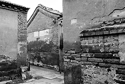 Detail of old walls in narrow hutong in Beijing China