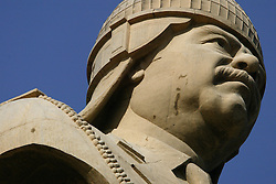 One of four bronze statues depicting Saddam Hussein, is seen outside the now partially destroyed Salam Palace in Baghdad, Iraq, Sept. 29, 2003. According to Mowfaq Al-Tai, an Iraqi architect, the Salam Palace is most representative of the design and architecture used in the hundreds of palaces built for Saddam Hussein.