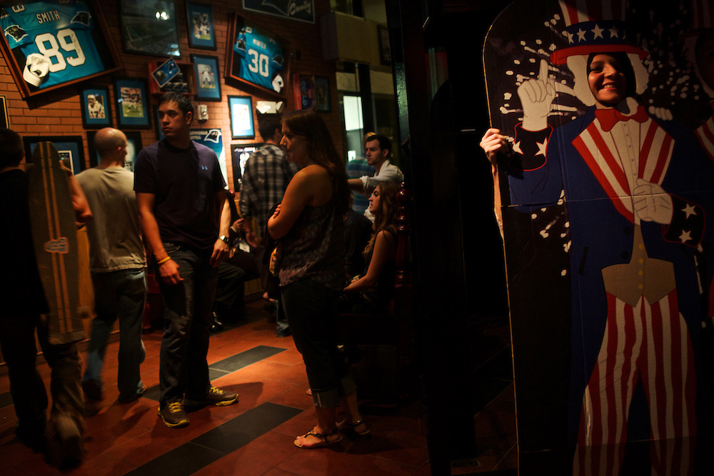 Patrons entertain themselves with an Uncle Sam cutout as they wait to be seated at Carolina Ale House on College Street during the 2012 Democratic National Convention on Wednesday, September 5, 2012 in Charlotte, NC.