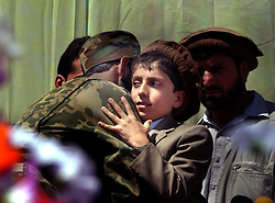 KABUL,AFGHANISTAN - SEPT. 9: Ahmad Massoud, the son of the slain leader Ahmad Shah Massoud  hugs and kisses dignitaries, soldiers and guests during a ceremony in Kabul Sports Stadium September 9, 2002  to comemerate the one-year anniversary of the death of his father.   (Photo by Ami Vitale/Getty Images)