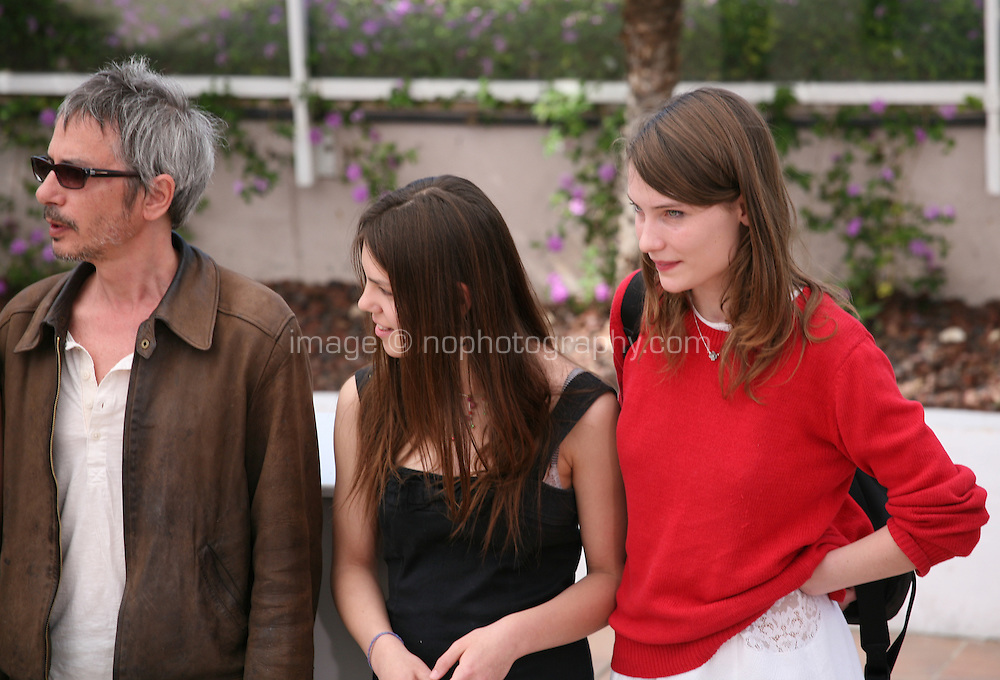 Leos Carax, Elise Lhomeau, Jeanne Disson, at the Holy Motors photocall at the 65th Cannes Film Festival France. Wednesday 23rd May 2012 in Cannes Film Festival, France.