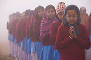 A group of school children in  a rural village assemble to pray and do exercises before school lessons begin, Chita Kalaan, Punjab, India